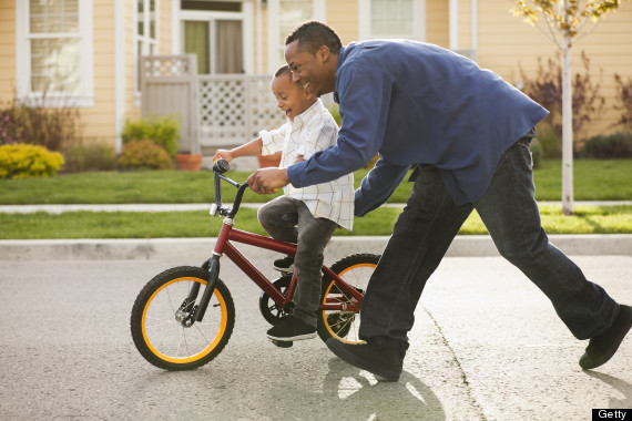 Kid Riding Bike With Training Wheels